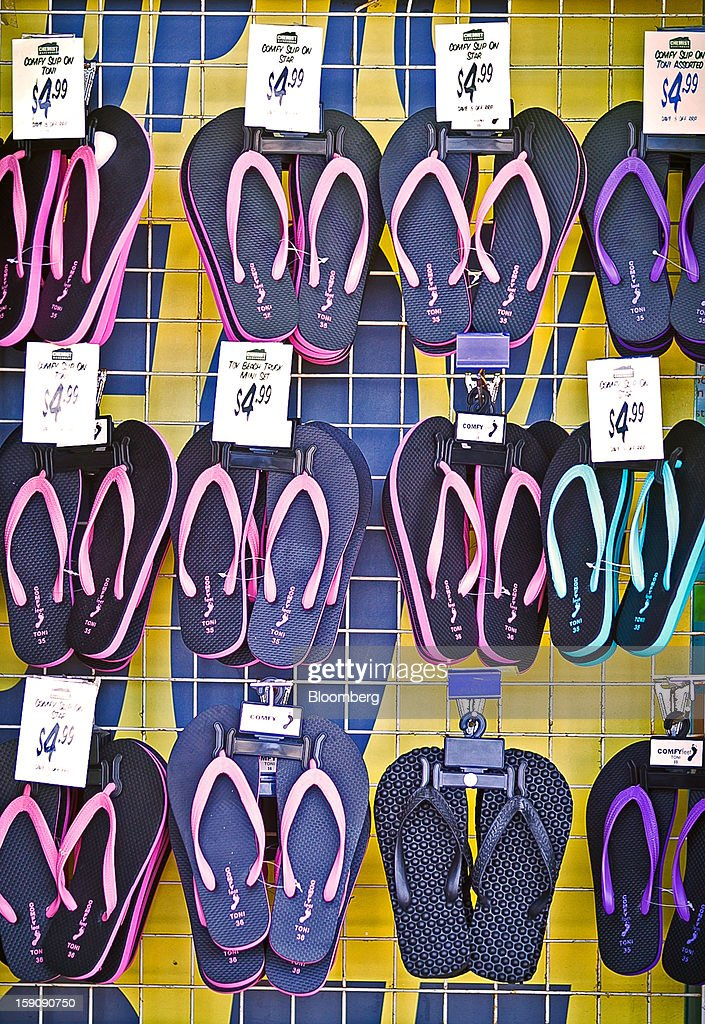 Rubber flip-flops are displayed for sale at a store at Bondi Beach in Sydney, Australia, on Monday, Jan. 7, 2013. The Bureau of Statistics is scheduled to release retail sales data on Jan. 9. Photographer: Ian Waldie/Bloomberg via Getty Images