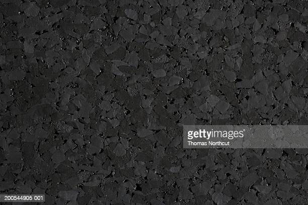 Rubber flooring made from chunks of recycled rubber, full frame