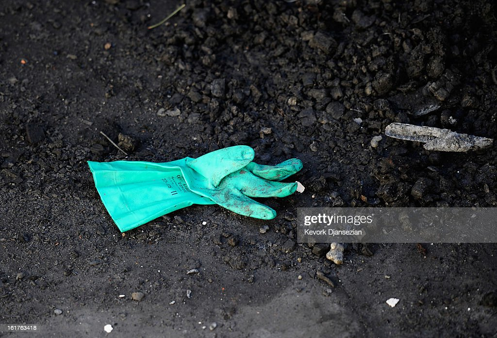 A rubber glove sits inside the burned out cabin where the remains of multiple murder suspect and former Los Angeles Police Department officer Christopher Dorner were found on February 15, 2013 in Big Bear, California. Dorner, a former Los Angeles Police Department officer and Navy Reserve veteran, barricaded himself in the cabin near Big Bear, California, and engaged law enforcement officers in shootout, shooting two police, killing one and wounding the other. Dorner's, who's body was identified after being found, was wanted in connection with the deaths of an Irvine couple and a Riverside police officer.