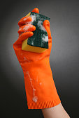 Rubber Gloved Hand Holding Cleaning Sponge