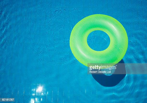 Rubber ring, floating in swimming pool.