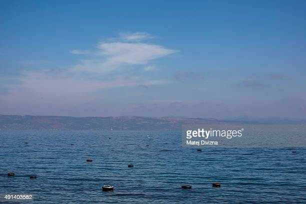 Rubber rings float as refugees and migrants arrive on the shores of the Greek island of Lesbos after crossing the Aegean sea from Turkey on an...