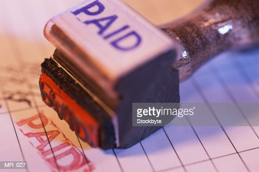 Rubber stamp marked Paid on top of stamped document