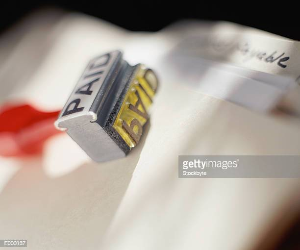 Rubber stamp on top of file folder