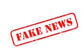 FAKE NEWS red rubber stamp over a white background