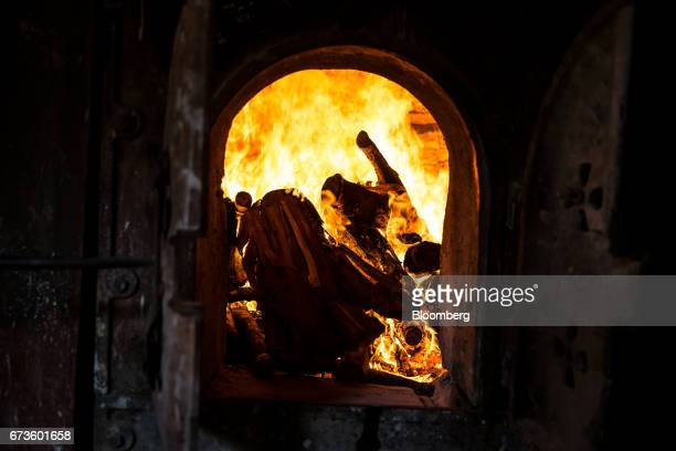 Rubberwood burns inside a furnace at the factory of the Geragama Tea Estate operated by Pussellawa Plantations Ltd in Pilimathalawa Central Sri Lanka...
