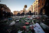 Rubbish and broken bottles of glass lay on the ground near the Barcaccia fountain which was damaged by Feyenoord fans who clashed with police on...
