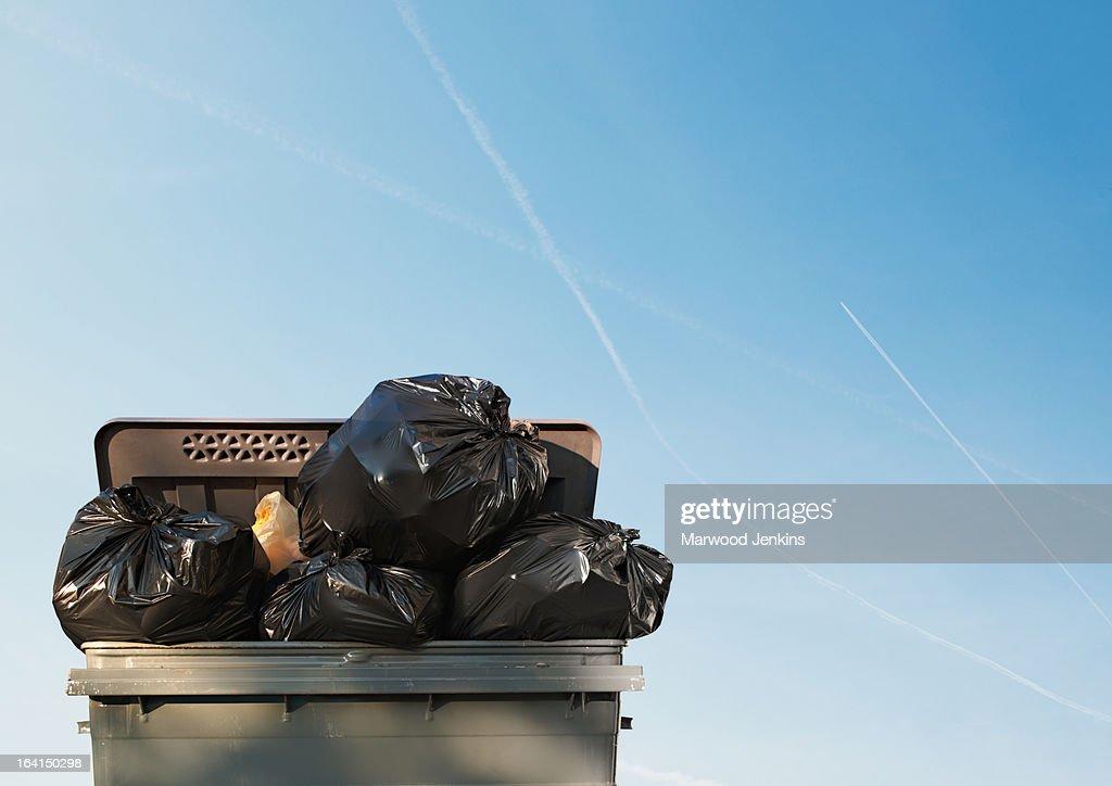 Rubbish bin against blue sky