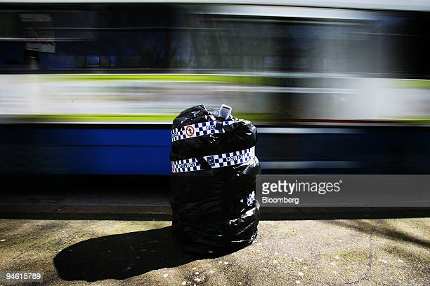 A rubbish bin is sealed shut with police tape outside a delegate hotel during day three of the AsiaPacific Economic Cooperation meeting in Sydney...