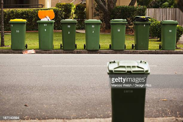 Rubbish Bins On A Curb In A Residential Area