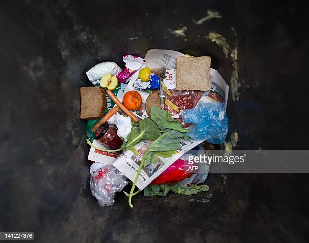A rubbish can containing food is pictured in Frankfurt / Oder eastern Germany on March 13 2012 German Agriculture and Consumer Affairs Ministry urged...