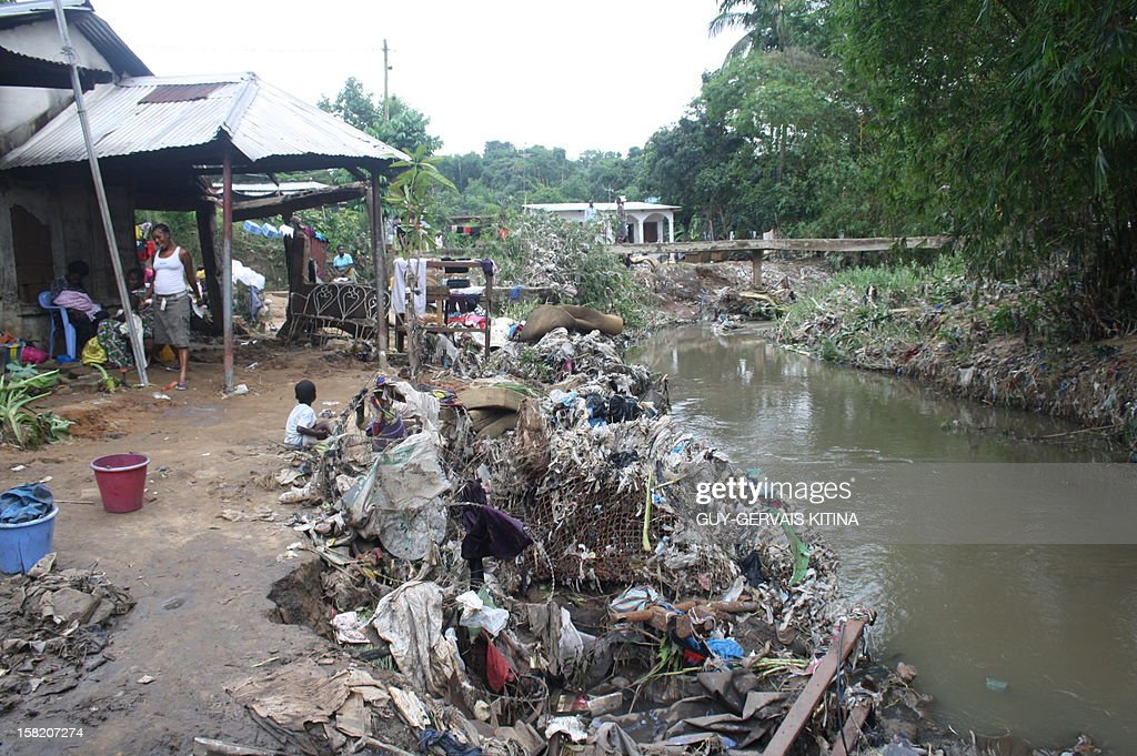 Rubbish covers the bank of the Mfilou river following a flood caused by torrential rains, on December 11, 2012 in Brazzaville. At least 13 people died in the Republic of Congo and two dozen others were injured after this flood caused homes to collapse in southern Brazzaville over the weekend, authorities said on December 10.