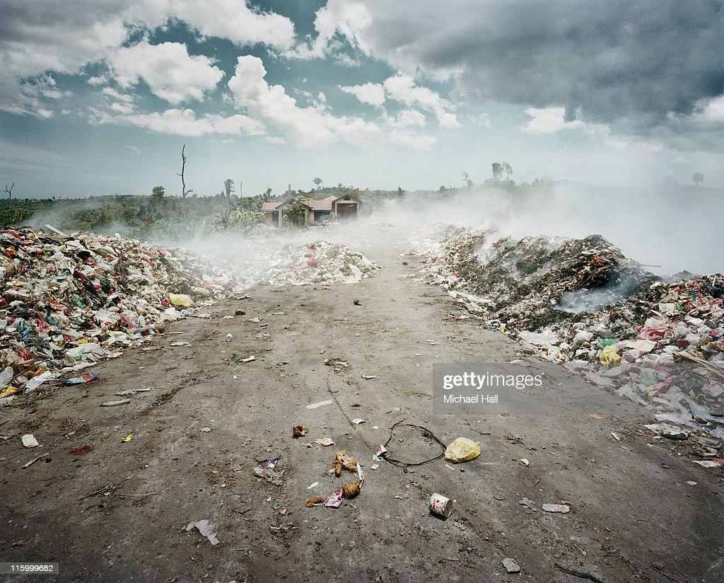 Rubbish dump on fire : Stock Photo