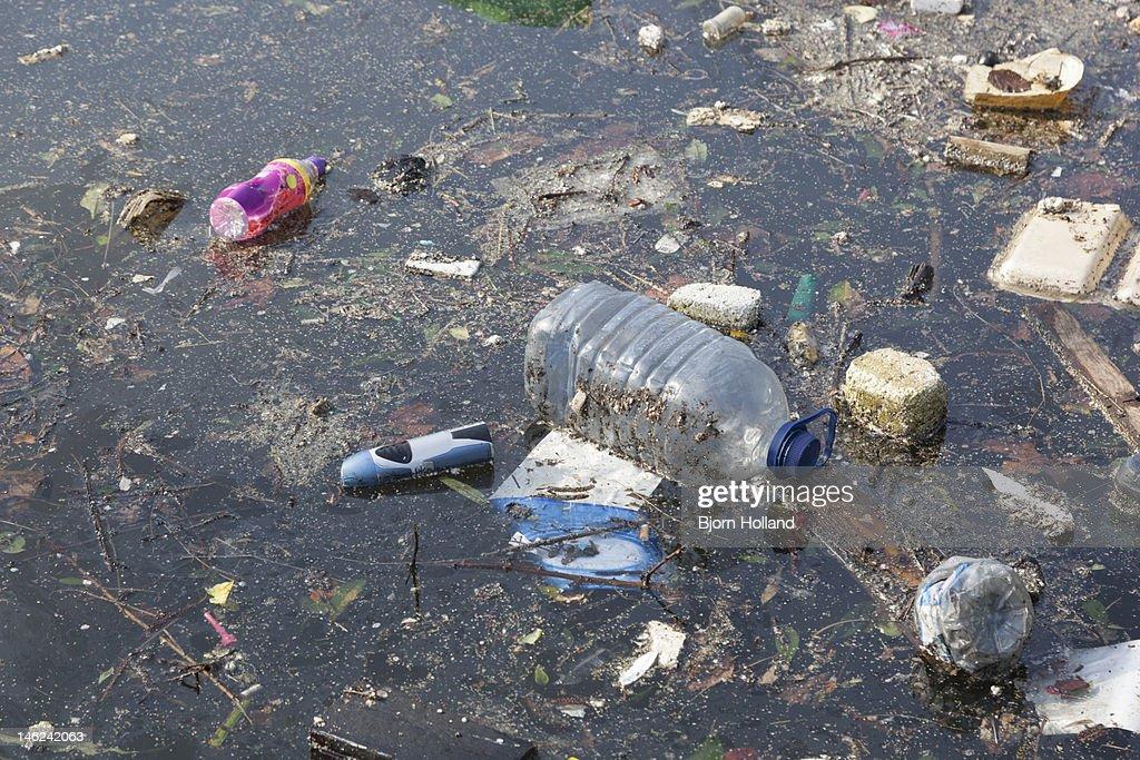 Rubbish in a river : Stock Photo