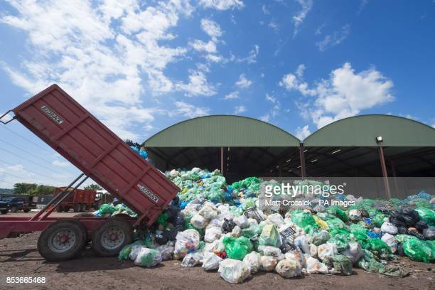 Rubbish is deposited at the recycling centre at the Glastonbury Festival at Worthy Farm in Somerset All waste on site is sorted into recycling groups...