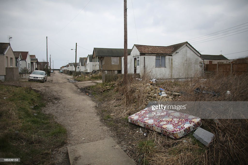 Rubbish is discarded in front of dilapidated properties in the seaside town of East Jaywick, the most deprived place in England, on April 3, 2013 in Jaywick, England. The Government's 2011 Indices of Multiple Deprivation' measure ranks Jaywick as the most deprived of all 32,482 small wards in England and Wales. The area also has the greatest number of young people not in employment, education or training; one third of 16 to 24 year-olds claim Jobseeker's Allowance, compared to the national average of 6 per cent. Changes to the benefits and tax system which came into force on April 1, 2013 have included a cut in housing benefit payments for working-age social housing tenants whose property is deemed larger than they need and council tax support payments now being administered locally.