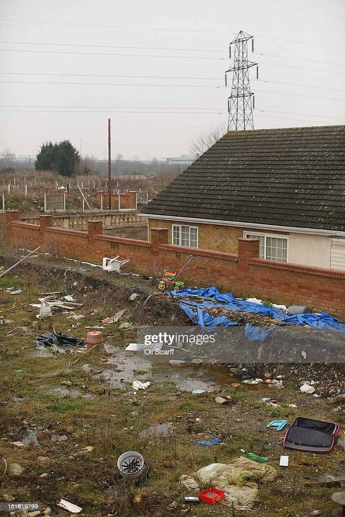 Rubbish is discarded on the portion of the Dale Farm traveller's camp which was cleared of residents and structures by Basildon Council on February 13, 2013 in Crays Hill, England. Basildon Council have approved a new site to accommodate the displaced travellers, which lies less than 800 meters from Dale Farm. Following Basildon Council's eviction in October 2011, which was estimated to have cost 7 million GBP, many travellers now reside on the access road for the legal portion of the Dale Farm site.