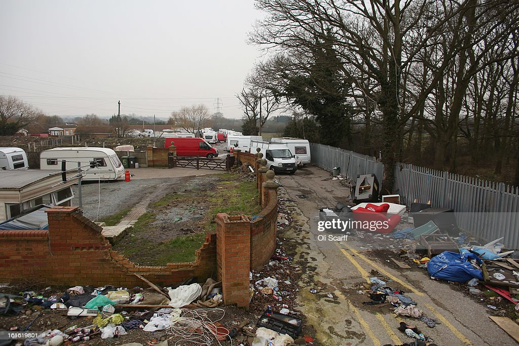 Rubbish is discarded on the portion of the Dale Farm traveller's camp which was cleared of residents and structures by Basildon Council , on February 13, 2013 in Crays Hill, England. Basildon Council have approved a new site to accommodate the displaced travellers, which lies less than 800 meters from Dale Farm. Following Basildon Council's eviction in October 2011, which was estimated to have cost 7 million GBP, many travellers now reside on the access road for the legal portion of the Dale Farm site.
