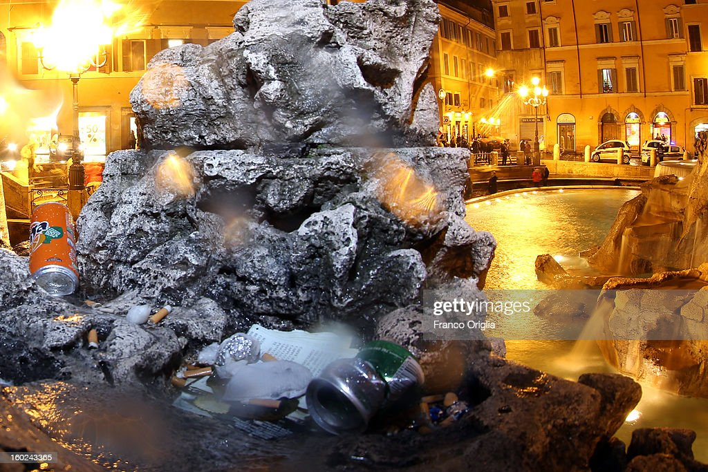 Rubbish is left on the deteriorated marbles of Trevi Fountain on January 28, 2013 in Rome, Italy. FENDI Chairman and CEO Pietro Beccari together with Karl Lagerfeld and Silvia Venturini Fendi and the representatives of the City of Rome, including the Mayor Gianni Alemanno, today announced the sponsorship of the restoration of Rome's most iconic fountain.