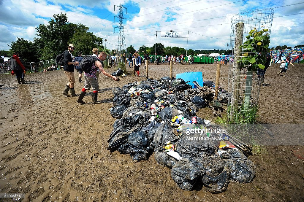 Rubbish is pictured on day four of the Glastonbury Festival of Music and Performing Arts on Worthy Farm near the village of Pilton in Somerset, South West England on June 25, 2016. / AFP / Andy Buchanan