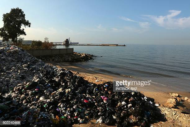 Rubbish is piled up at a temporary garbage dump on a beach in Zalka north of Beirut on December 22 2015 Lebanon's rubbish crisis began in July when...