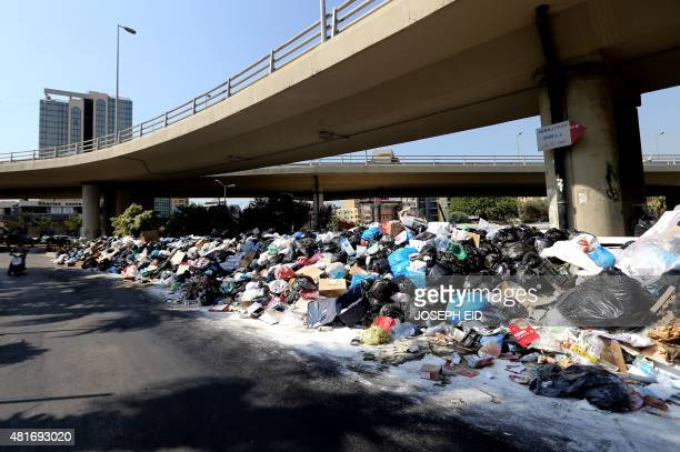 Rubbish is seen piled up on a street in the Lebanese capital Beirut on July 23 2015 after protesters shut down the country's largest landfill For...