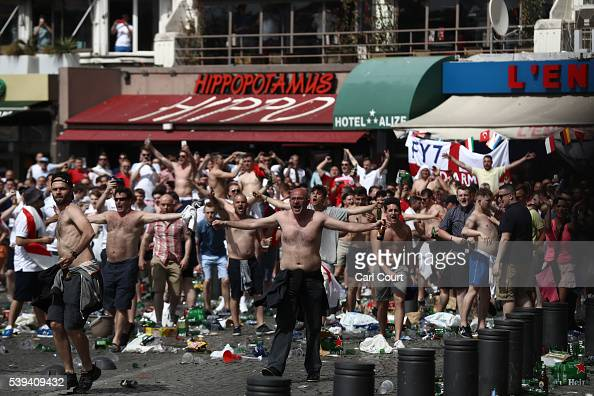 Rubbish lines the streets as England fans gather cheer and clash with police ahead of the game against Russia later today on June 11 2016 in...