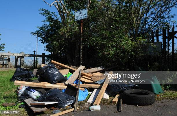 Rubbish that has been dumped next to a sign saying 'No Dumping' sign in Ealing London