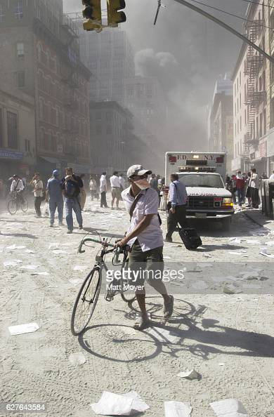 Rubble debris and smoke cloud the streets of Lower Manhattan after planes crashed into the World Trade Center on Sept 11 2001
