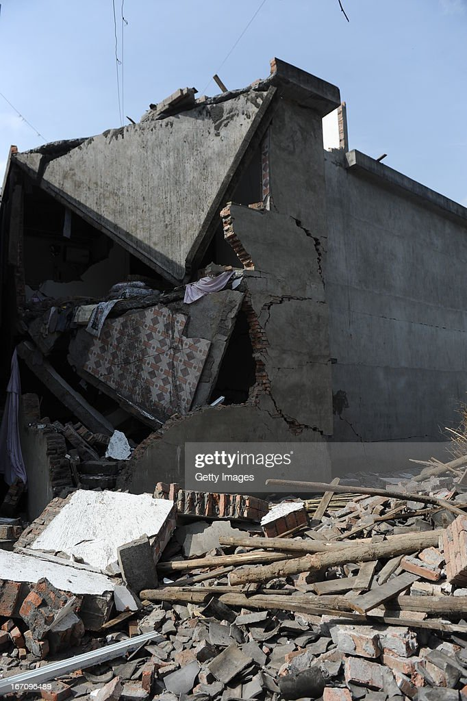 YA'AN, CHINA - APRIL 20: (CHINA OUT) Rubble from a collapsed building after a strong earthquake hit Southwest China's Sichuan Province on April 20, 2013 in Ya'an, Sichuan Province of China. The devastating earthquake hit the region in the morning claiming over 100 lives and injuring thousands.