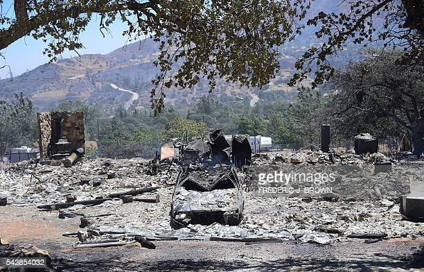 Rubble from a demolished home with vehicle out front are seen in the community of Squirrel Valley in Lake Isabella California on June 24 2016y An...
