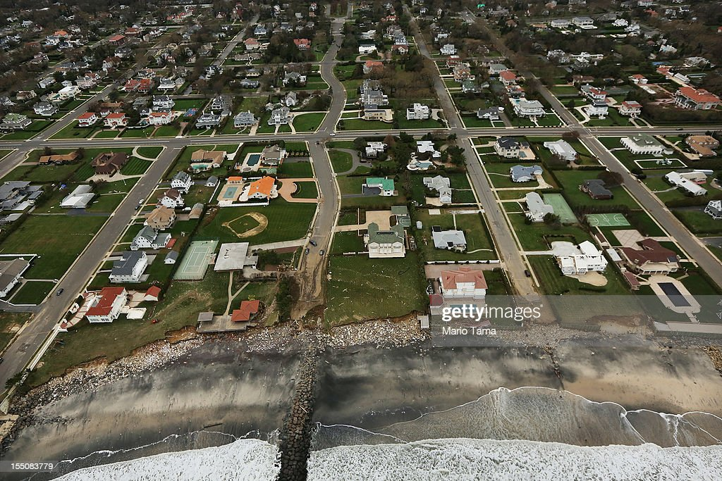 Rubble from Superstorm Sandy remains by homes at the edge of the Atlantic Ocean on October 31, 2012 in Long Branch, New Jersey. At least 50 people were reportedly killed in the U.S. by Sandy with New Jersey suffering massive damage and power outages.