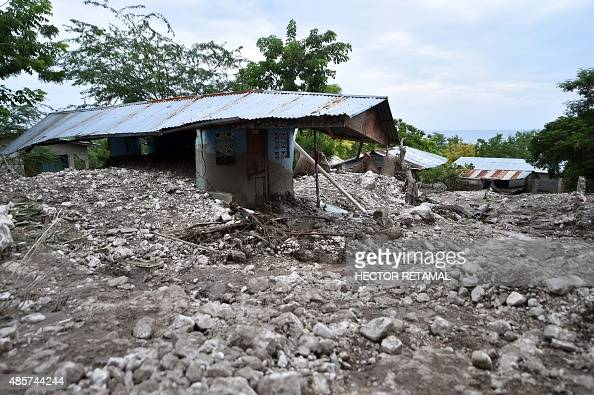 Rubble lies around houses destroyed by a mudslide caused by the rains from Tropical Storm Erika in Montrouis Haiti on August 29 2015 Erika left at...