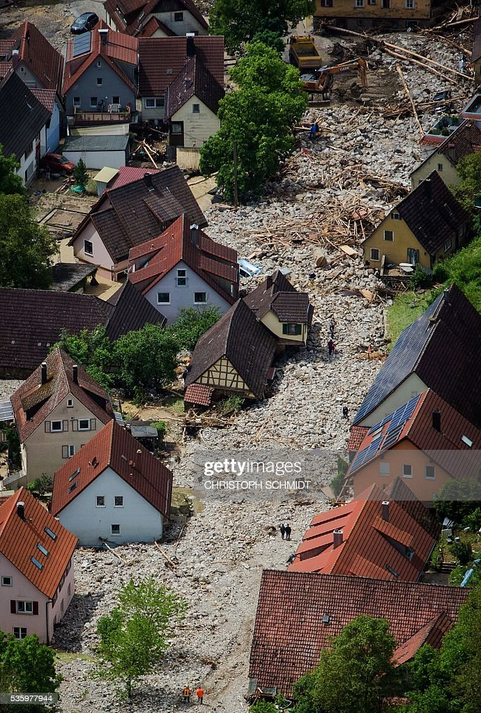 Rubble lies on a street on May 30 2016 in Braunsbach following a storm and heavy rain Four people died and several more were injured in southern...