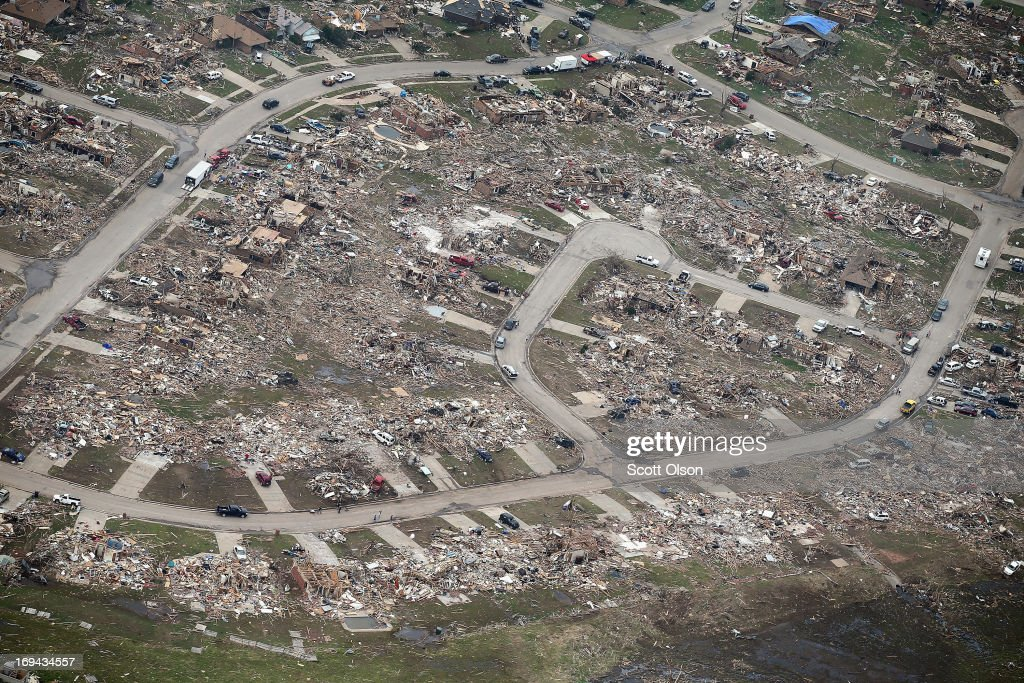 Rubble sits at the end of driveways where homes once stood before they were destroyed by a tornado, on May 24, 2013 in Moore, Oklahoma. A two-mile wide EF5 tornado touched down in Moore May 20 killing at least 24 people and leaving behind extensive damage to homes and businesses. U.S. President Barack Obama promised federal aid to supplement state and local recovery efforts.