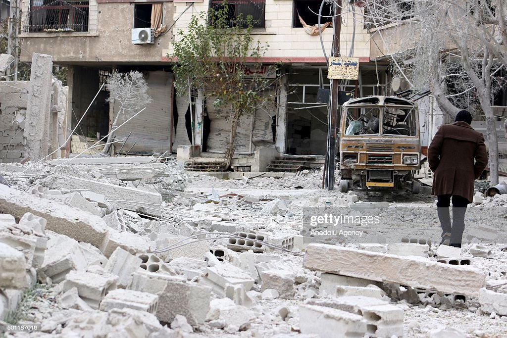 Rubbles of damaged buildings are seen after the war crafts belonging to the Russian Army carried out airstrikes on oppositioncontrolled Douma Zemelka...