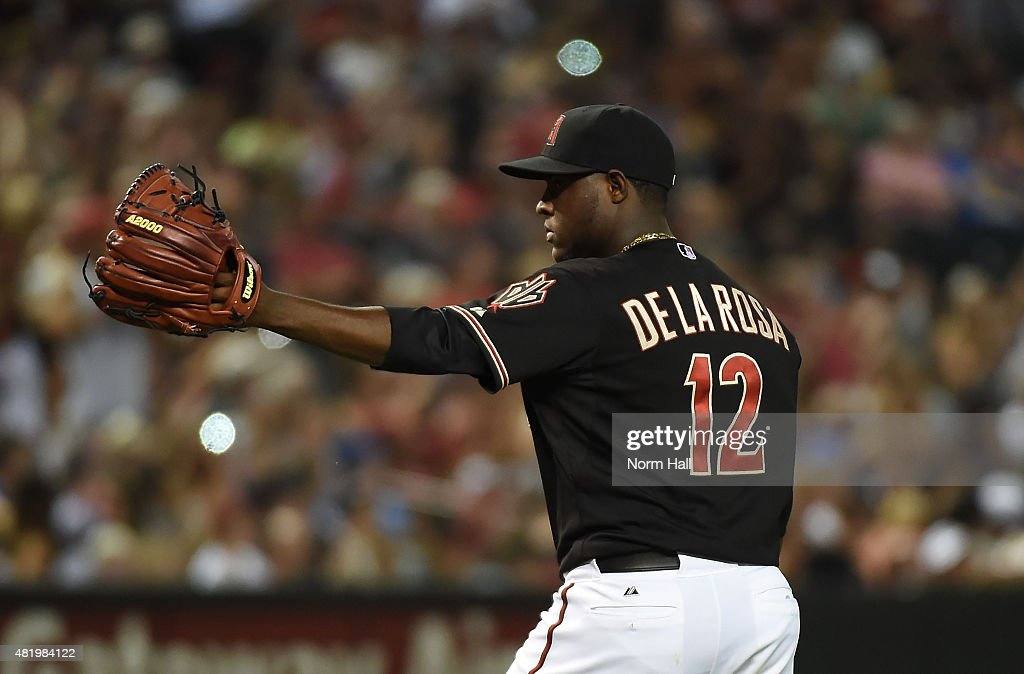 Rubby De La Rosa of the Arizona Diamondbacks points to teammates in celebration after finishing the eighth inning against the Milwaukee Brewers at...