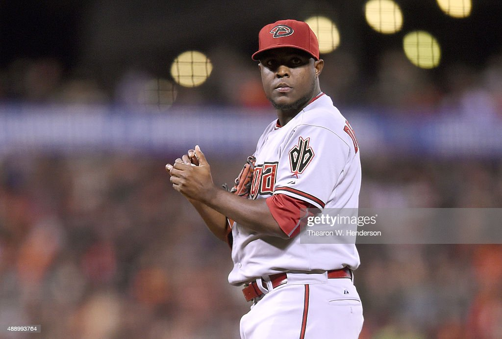Rubby De La Rosa of the Arizona Diamondbacks rubbing up a new ball as he waits for manager Chip Hall to come take him out of the game against the San...
