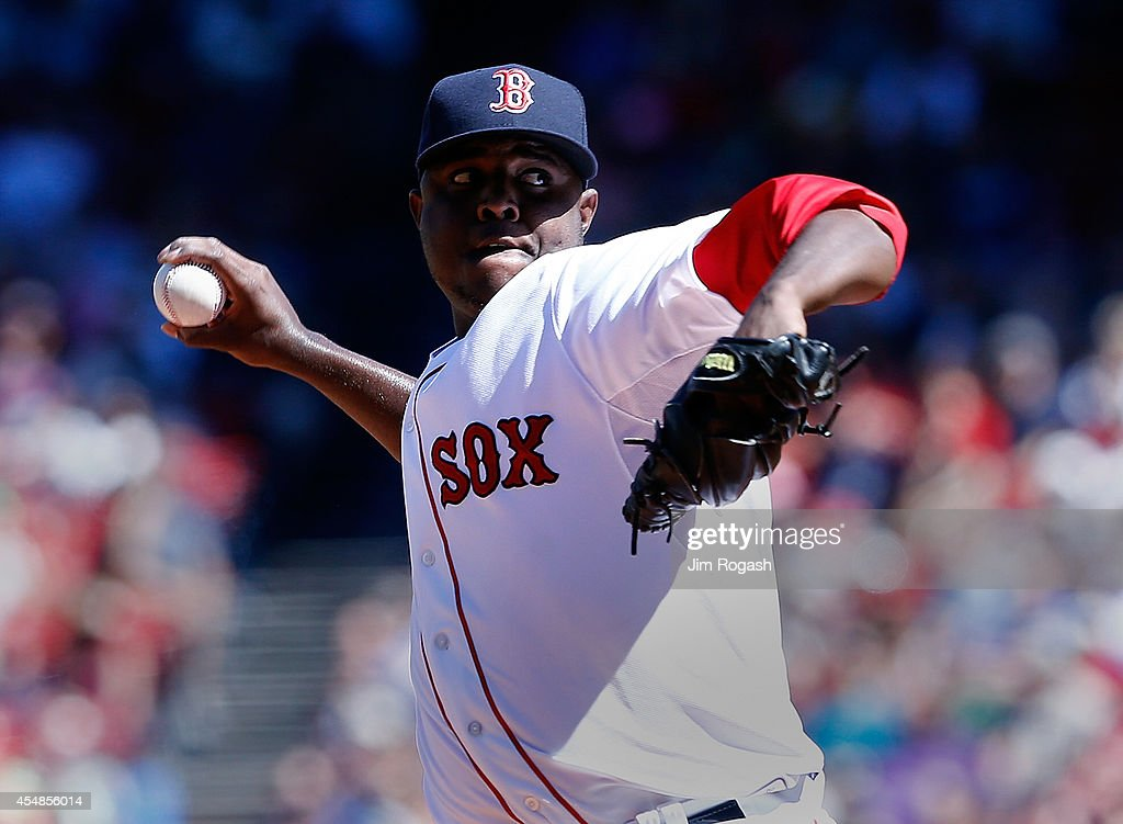 Rubby De La Rosa of the Boston Red Sox throws against the Toronto Blue Jays in the first inning at Fenway Park on September 7 2014 in Boston...