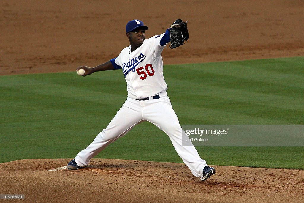Rubby De La Rosa #50 of the Los Angeles Dodgers pitches against the Colorado Rockies in the second inning of the game at Dodger Stadium on July 25, 2011 in Los Angeles, California.