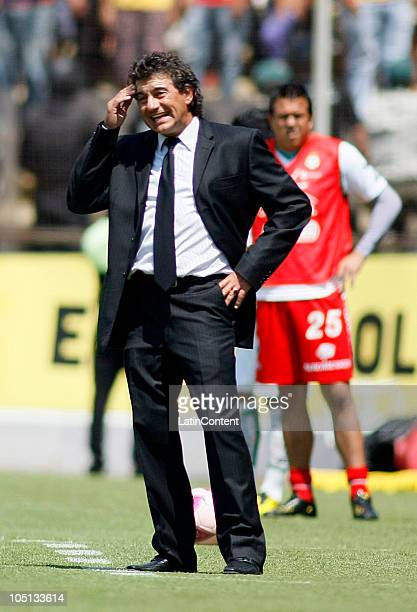 Rube Omar Romano head coach of Morelia in react during a match against Santos as part of the Apertura 2010 at Morelos Stadium on October 10 2010 in...