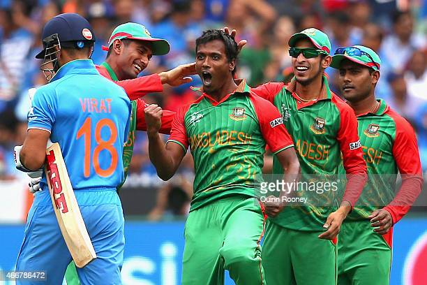 Rubel Hossain of Bangladesh celebrates getting the wicket of Virat Kohli of India during the 2015 ICC Cricket World Cup match between India and...