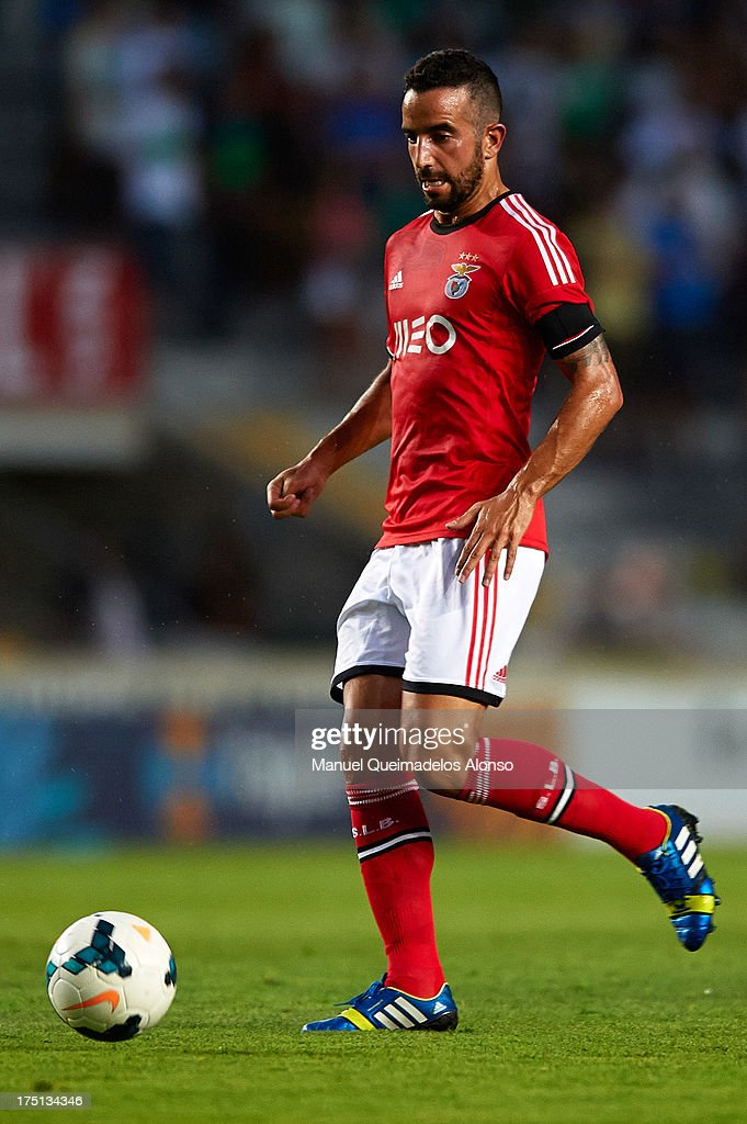 Ruben Amorin of Benfica runs with the ball during a friendly match between Elche CF and Benfica at Estadio Martinez Valero on July 31, 2013 in Elche, Spain.