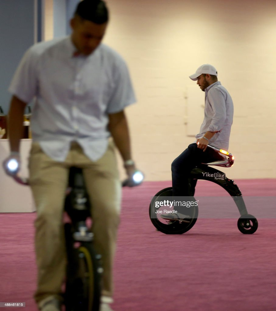 Ruben Barzilay (r) Rides The Electric Powered, Yikebike, On Display At The