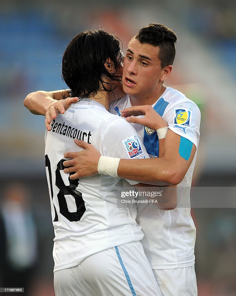 Ruben Bentancourt of Uruguay celebrates scoring his side's third goal with team-mate Jose Gimenez during the FIFA U20 World Cup Group F match between Ukbekistan and Uruguay at Akdeniz University Stadium on June 29, 2013 in Antalya, Turkey.
