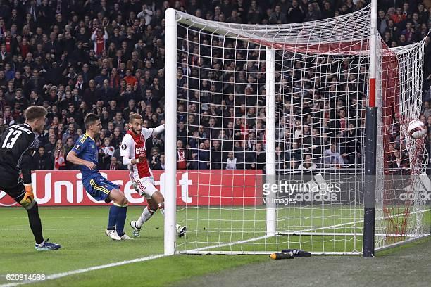 Ruben Blanco of Celta de Vigo Nemanja Radoja of Celta de Vigo Hakim Ziyech of Ajax Amsterdam scoresduring the UEFA Europa League group G match...