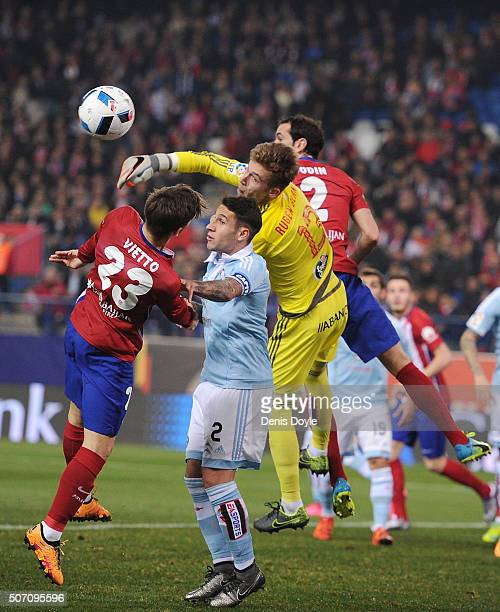 Ruben Blanco of Celta Vigo clears the ball from Luciano Vietto of Club Atletico de Madrid during the Copa del Rey Quarter Final 2nd Leg match between...