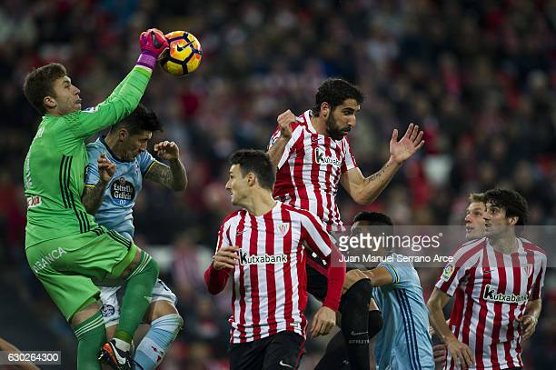 Ruben Blanco of RC Celta de Vigo competes for the ball with Raul Garcia of Athletic Club during the La Liga match between Athletic Club Bilbao and RC...