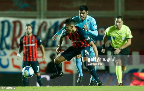 Ruben Botta Montero of San Lorenzo fights for the ball with Alexis Zarate of Temperley during a match between San Lorenzo and Temperley as part of...