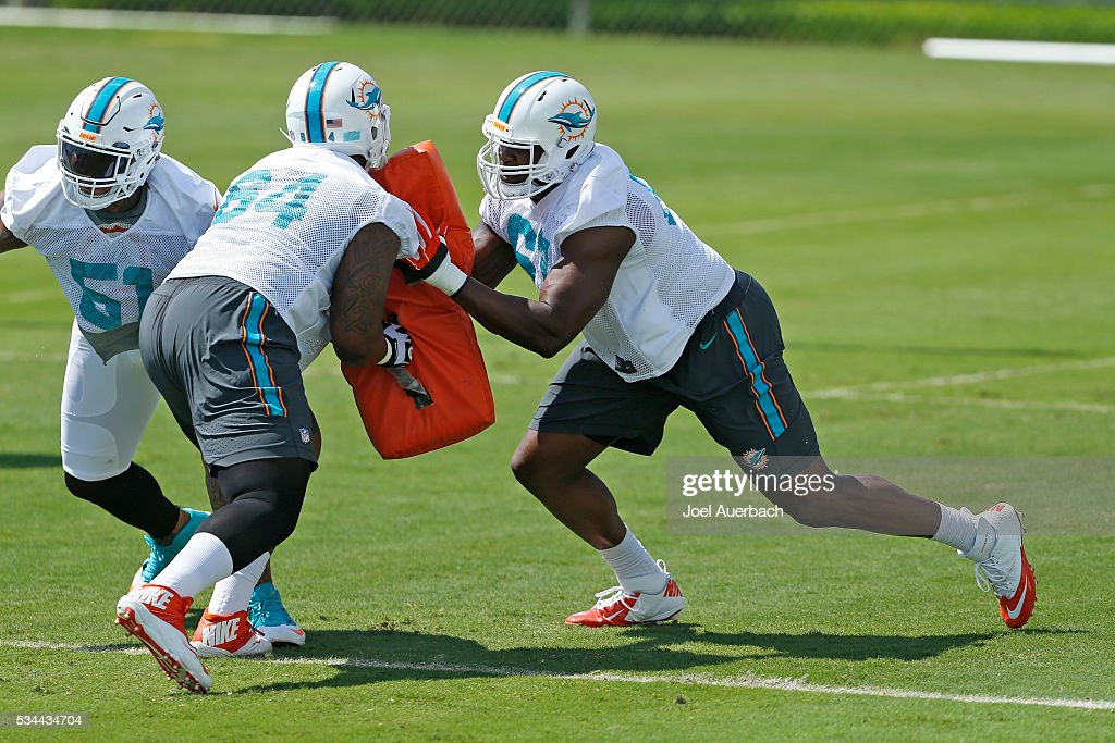 Ruben Carter #64 and <a gi-track='captionPersonalityLinkClicked' href=/galleries/search?phrase=Laremy+Tunsil&family=editorial&specificpeople=11377896 ng-click='$event.stopPropagation()'>Laremy Tunsil</a> #67 of the Miami Dolphins run a drill during the team's OTA's on May 26, 2016 at the Miami Dolphins training facility in Davie, Florida.
